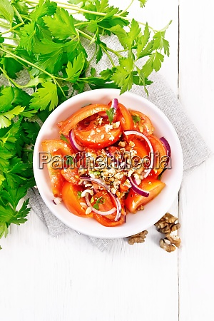 salad with tomato and walnut in