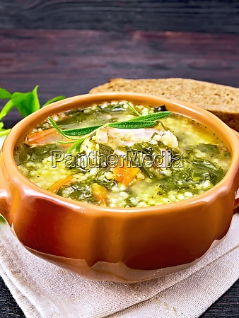 soup with couscous and spinach in