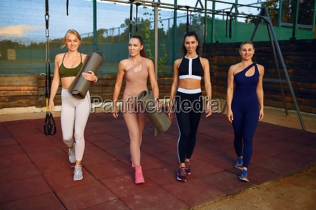 womens fitness group on sports ground