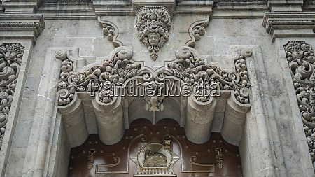 beautiful sculpted arch on a building