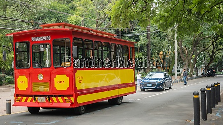 red and yellow trolley car on