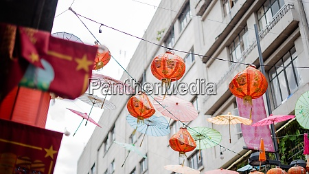 traditional chinese lamps and umbrellas hanging