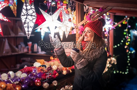 woman buying decoration and baubles on