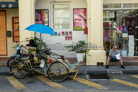street life of trishaw driver and