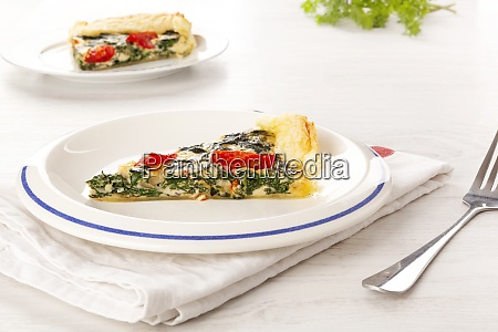 home made spinach quiche on plate