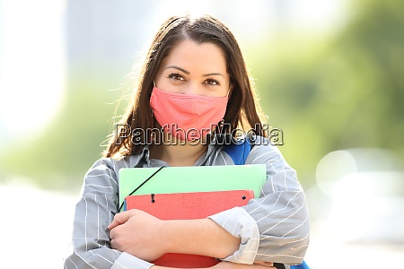 happy student with mask posing in