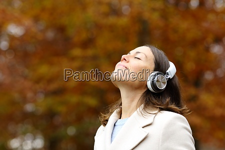 middle age woman breathing fresh air