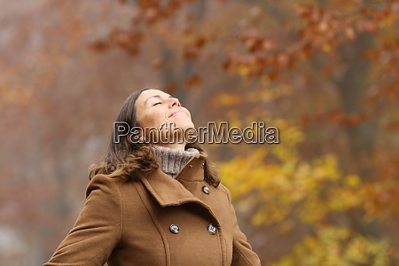 middle aged woman breathing fresh air