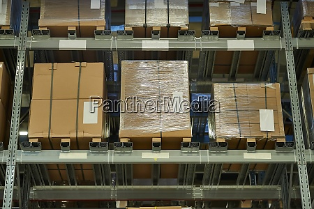 warehouse with stocked shelves of boxes