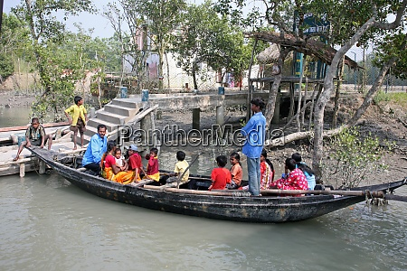 wooden boat crosses the river in