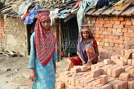 brick field workers carrying complete finish