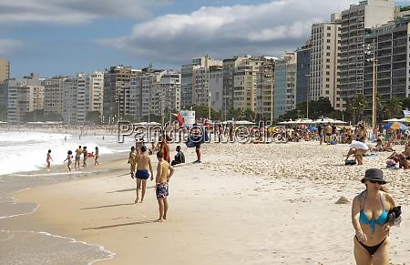 citizens sunbathe on the beach of