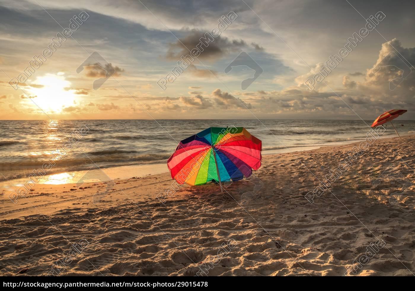 rainbow, umbrella, on, white, sand, at - 29015478
