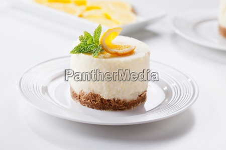 cheesecake dessert with organic oranges