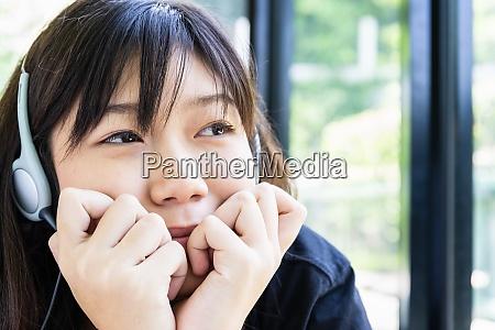 teenage girl with headphones and listening