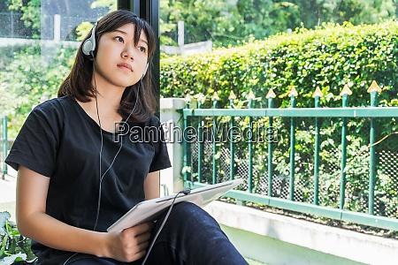 teenage female listening to the music