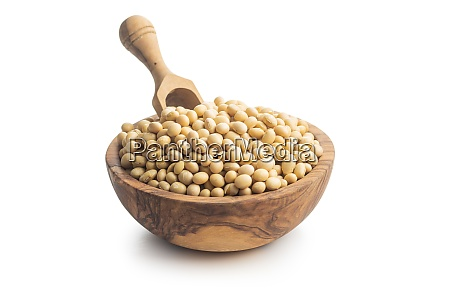 dried soy beans in wooden bowl