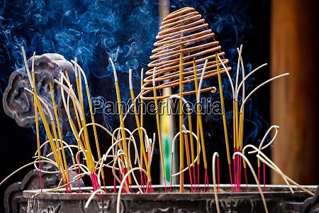 incense sticks in a buddhist temple