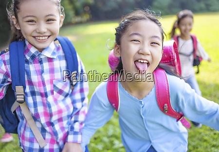 happy elementary school kids running on