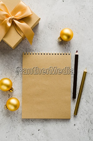 flat lay of blank brown notebook