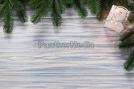 christmas blue wooden background with fir