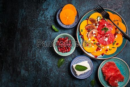 persimmon carpaccio salad with pomegranate feta