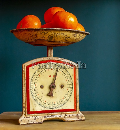 weighing tangerines in a retro vintage