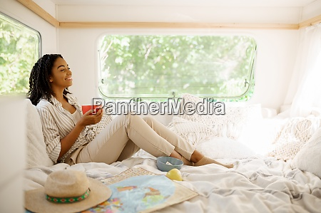 young woman relax in bed camping