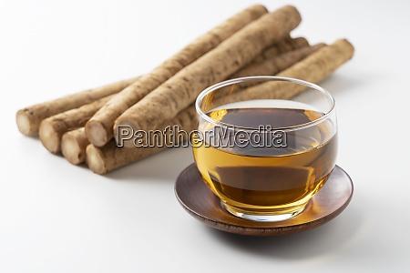 burdock tea on a white background