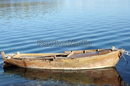 a wooden rowing boat tide down