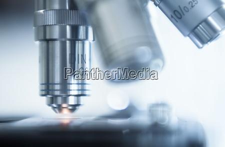 close up of laboratory microscope lens