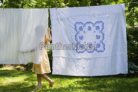 girl 6 7 with laundry in