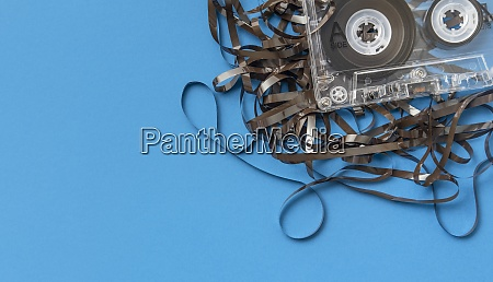 analog audio cassette on blue background