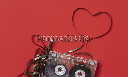 analog audio cassette on red background