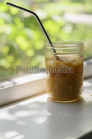 iced coffee on windowsill