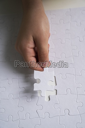 hand of child 6 7 arranging