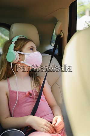 masked girl 6 7 listening to