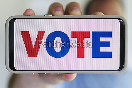 hand holding smartphone with voting message