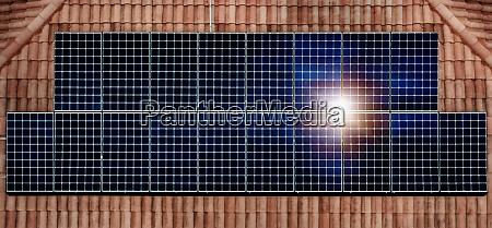 solar panels reflecting sun on house