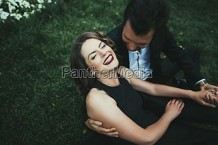 ukraine couple embracing in garden