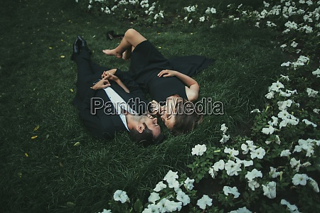 ukraine couple lying down on grass