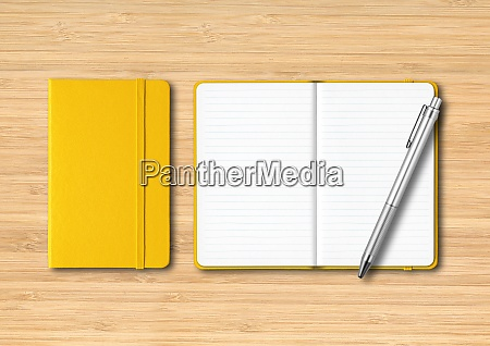 yellow closed and open lined notebooks