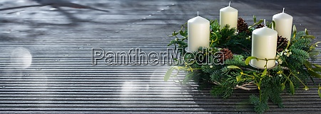 advent wreath on gray wooden planks