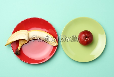 red ripe apple and banana lie