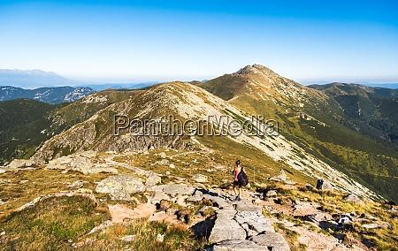 mountain ridge with hiking trail tourist