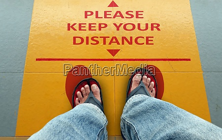 please keep your distance sign on