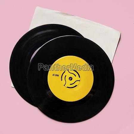 vintage records on pink background