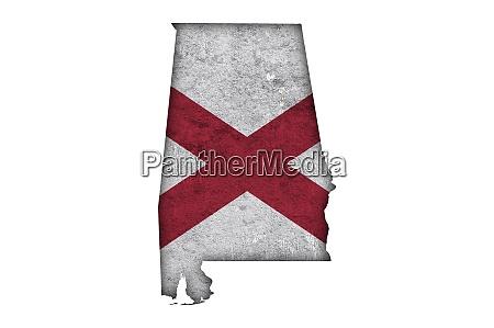 map and flag of alabama on