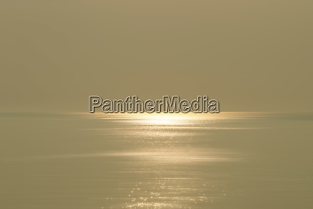 calm sea and sky with sunlight