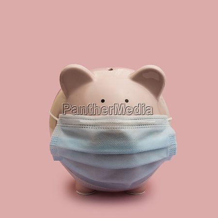 piggy bank with flu mask